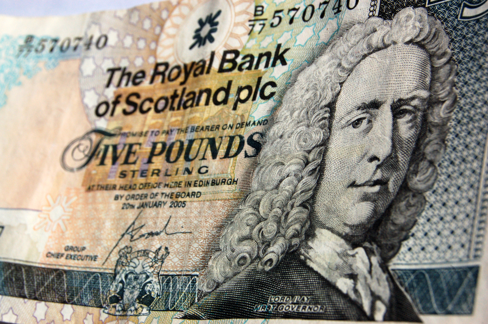 Royal Bank of Scotland reports first annual profit in a decade