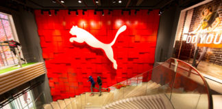 Puma shares rise on record sales results